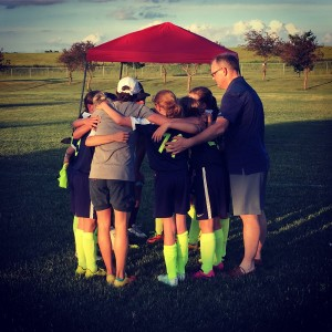 U10 girls 'Thunder', end of game team huddle.